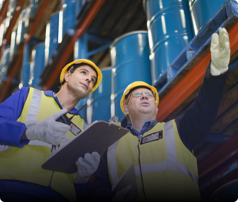two men in hard hats at a factory